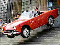 Maxwell Smart (Carell) drives red convertible down courthouse steps