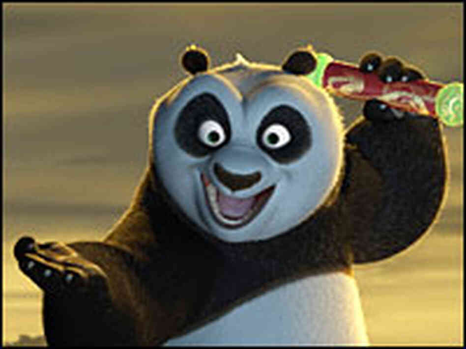 Po the Panda holds the Dragon Scroll in triumph