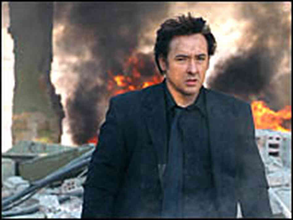 John Cusack plays a hitman in the satirical film 'War, Inc.'