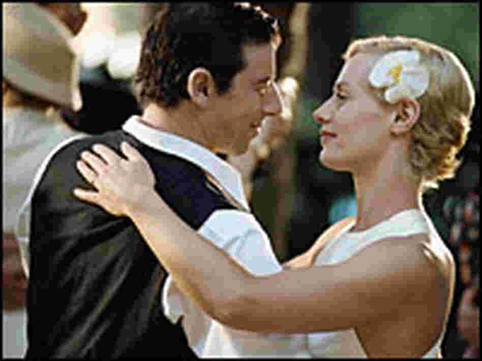 Patrick Bruel and Cecile de France, dancing