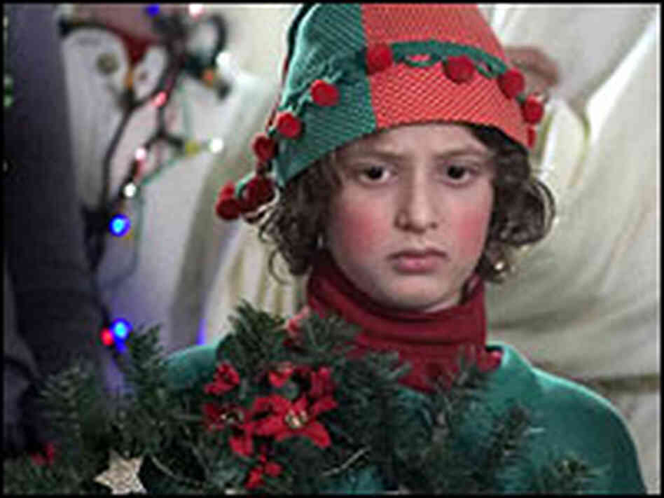 Noah Bernett as Scot in gaudy Christmas outfit