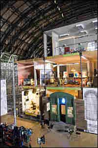 Warehouse interior with giant street-scene set