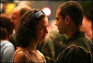 """Monica (Maria Dinulescu) and Sgt. David McLaren (Jamie Elman) dance in 'California Dreamin"""""""
