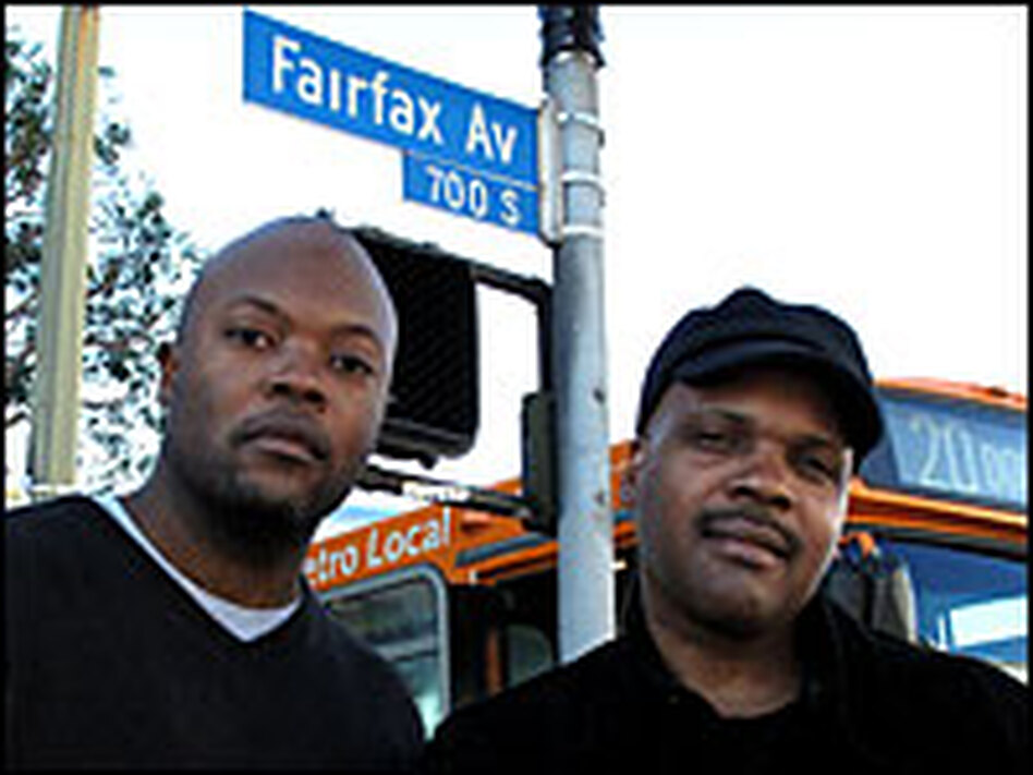 <strong>'The Shot Heard 'Round The World':</strong> <em>Notorious</em> screenwriters Cheo Hodari Coker and Reggie Rock Bythewood at the Los Angeles intersection where Christopher Wallace was fatally shot.