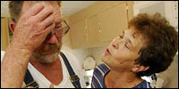 Donald and Colleen Bordelon share an emotional moment in the kitchen of their home in St. Bernard Parish.