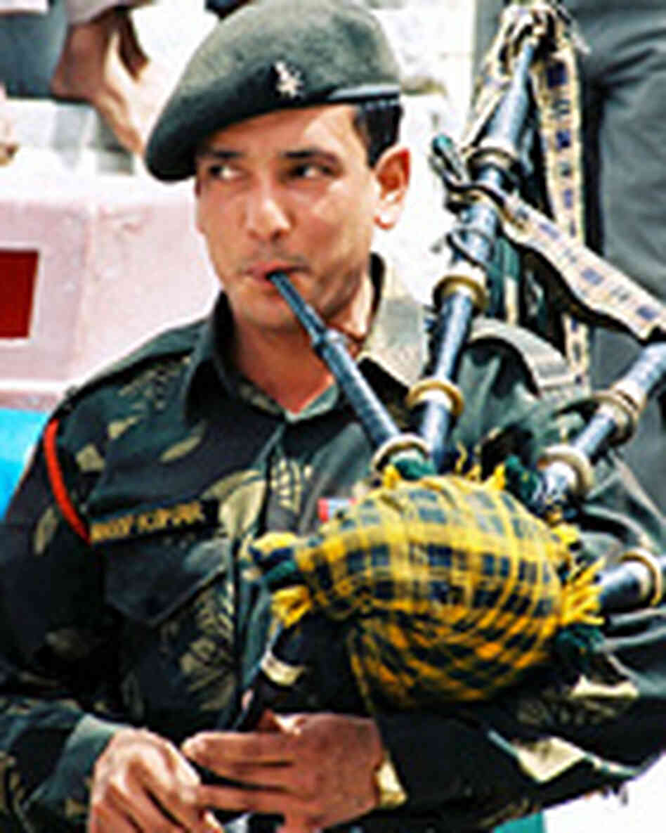 A soldier from the GarhwalRifles army pipe band playing the bagpipes.