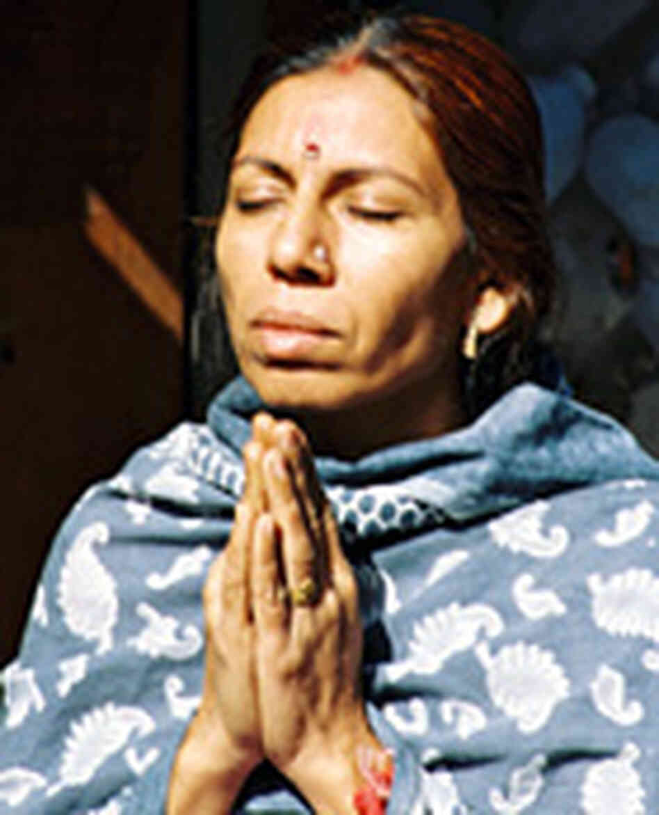 A Hindu woman praying