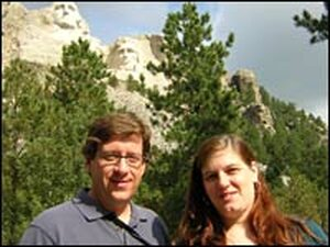 Jeff Brady and Andrea Seabrook in front of Mount Rushmore