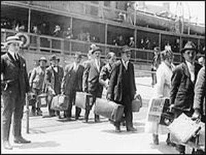 Immigrants arrive at Ellis Island, May 1920.