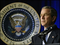 President George W. Bush at podium