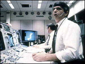Frederick Gregory (foreground) and Richard O. Covey, spacecraft communicators at Mission Control in Houston, watch helplessly as the shuttle Challenger explodes on Jan. 28, 1986.