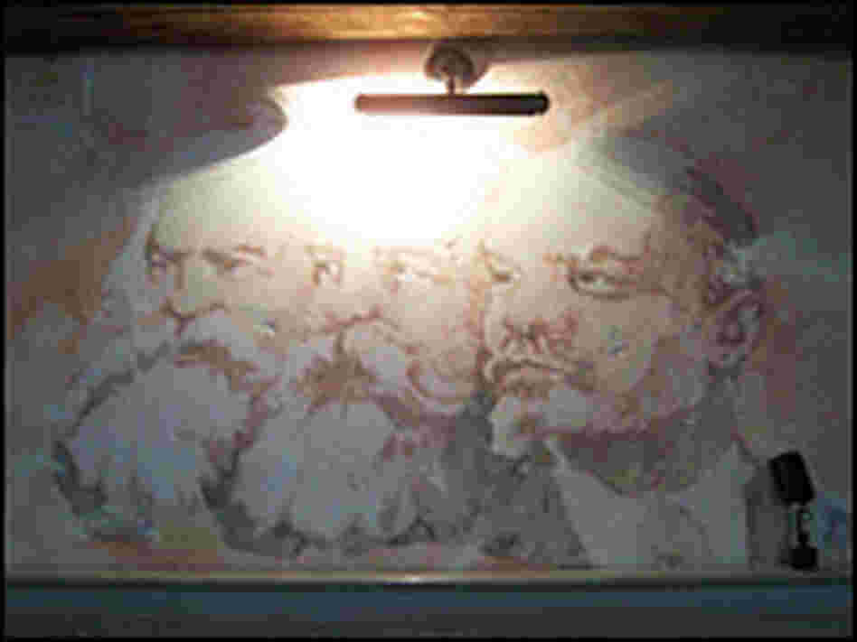 A fresco of Marx, Engels and Lenin in the dining room.