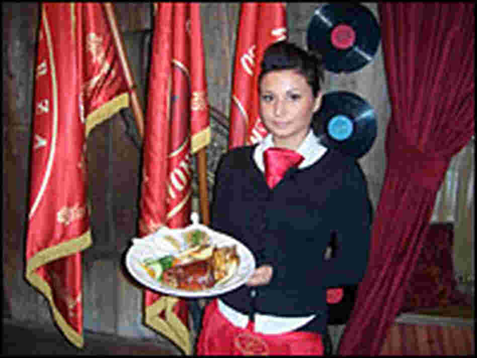 Wait staff clad in red ties are part of the Communist-era theme at Inn Under the Red Hog.