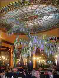 A colorful, domed, stained-glass ceiling adorns the central dining room