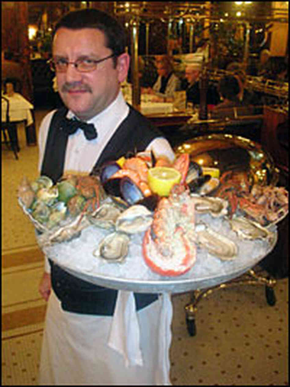 Waiter at Bofinger carries a platter of shellfish