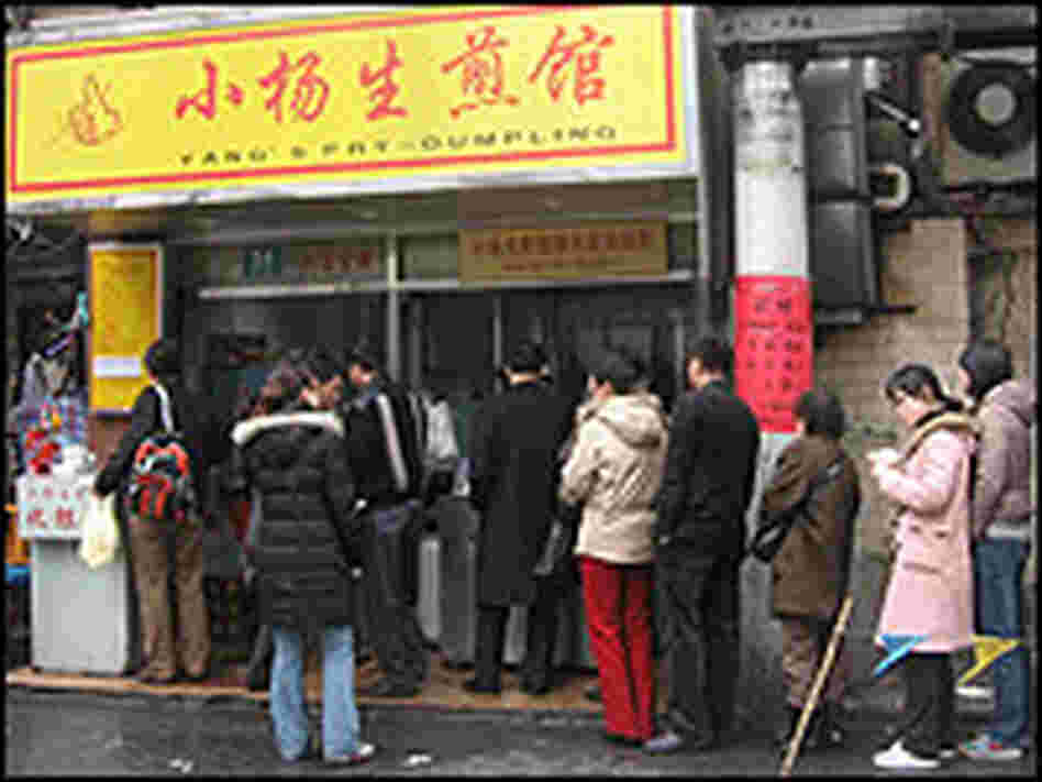A line of people waits outside Yang's Fried Dumpling in Shanghai