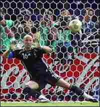 French goalkeeper Fabien Barthez misses a penalty shot by Italian defender Fabio Grosso.