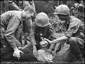 U.S. soldier in Vietnam supervises the waterboarding of a captured North Vietnamese soldier.