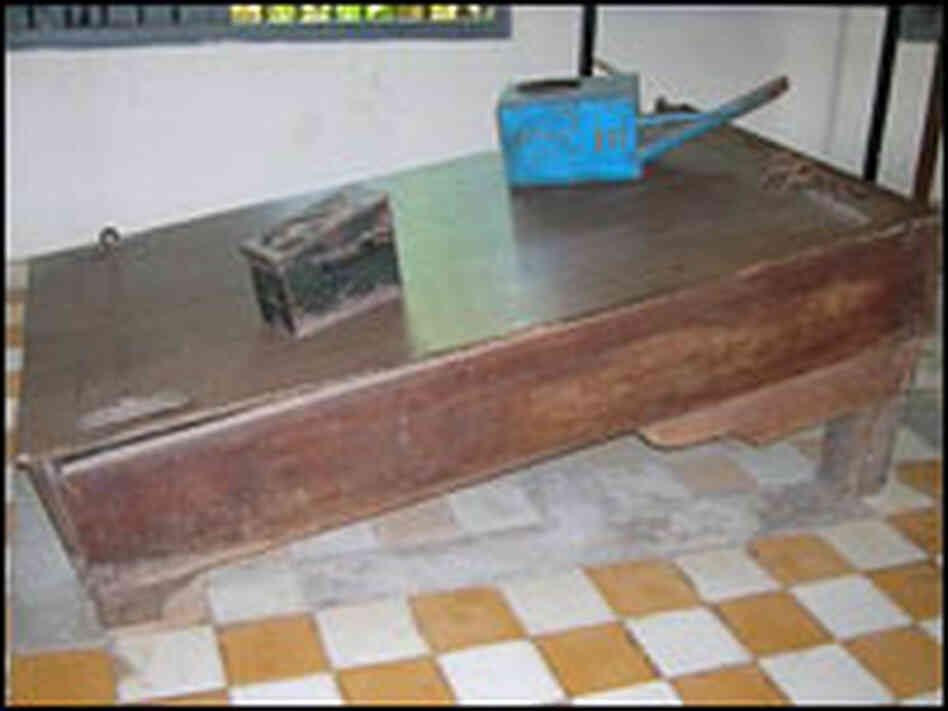 A waterboard and blue watering can used by the Khmer Rouge.