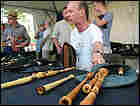 Hamish Moore of Dunkeld, Scotland shows off his handmade pipes at the Smithsonian Folklife Festival.