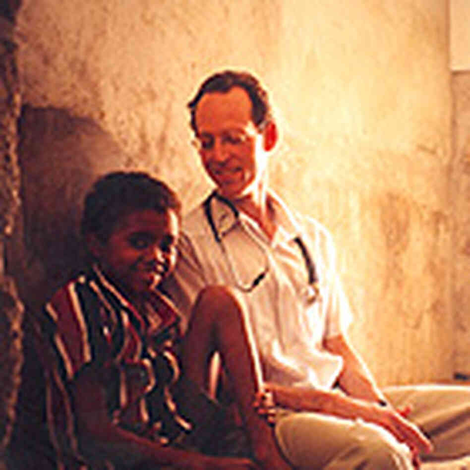 Dr. Farmer and a young Haitian boy named Alcante