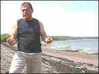 Tribal representative Fred Moore walks along the proposed LNG depot site.