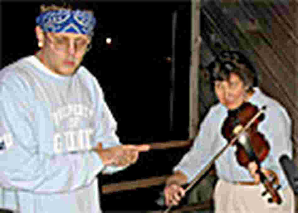 Hill Hop rapper Delivery and fiddler Beverly May rehearse on the porch at Appalshop