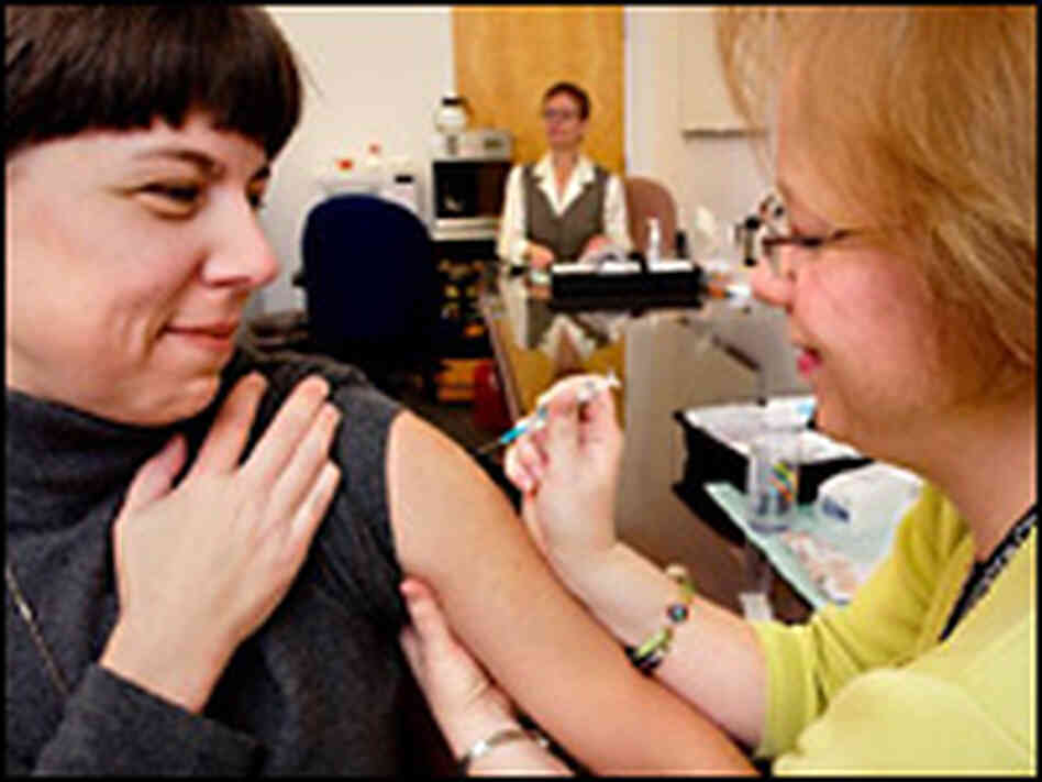 Pascale Krumm receives a flu vaccine from CDC Staff Nurse, Mollie McDonald-Waldron.