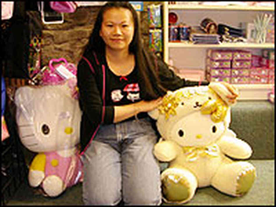 Vickie Pan Poses with Hello Kitty Dolls