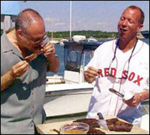 Mark Bittman, left, and Chris Schlesinger chew over Schlesinger's slow-grilled ribs.