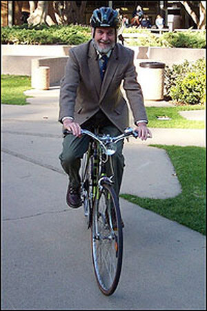 Donald Shoup on a bicycle.