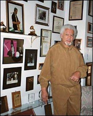 Frank Foster, with photos, awards and mementos at his Virginia home.