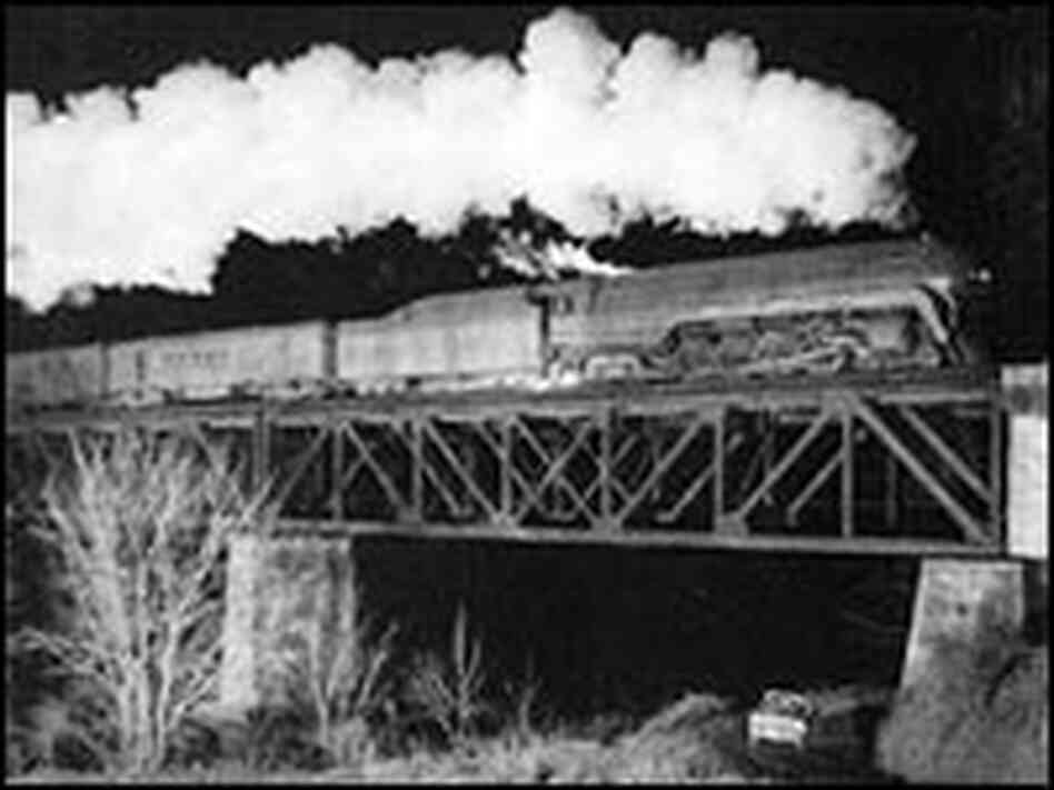 A Class J crosses a bridge over the New River at Radford, Va.