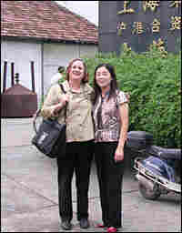 Author Pietra Rivoli stands with Tao Yong Fang, manager of a textile mill in Shanghai.