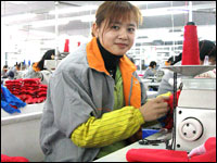 A seamstress in a Shanghai textile factory.