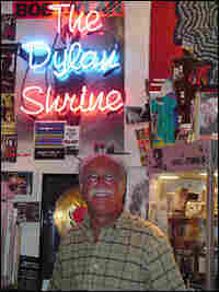 Mel Prussack stands in the middle of his shrine to Bob Dylan.
