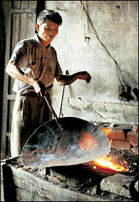 Black Smith makes a Wok