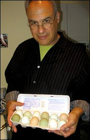 Bittman shows off a colorful assortment of eggs that will go into making the frittata.