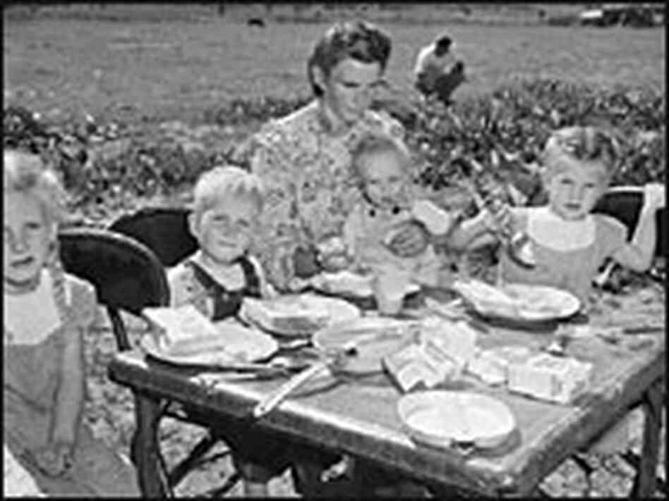 A mother and her children eat breakfast after the 1953 Short Creek raid.