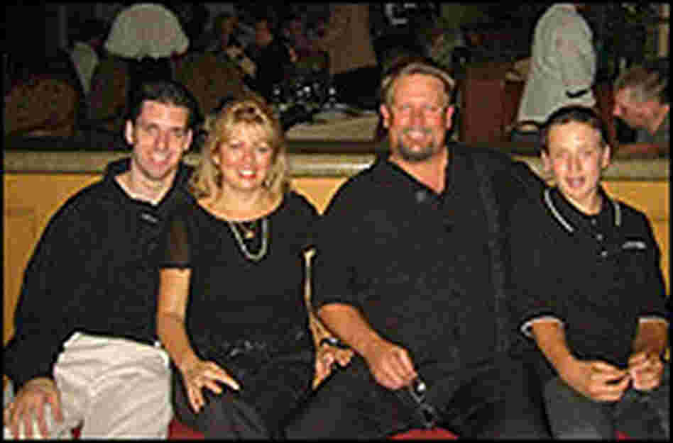 Matthew with his mother, Debbie, stepfather, Greg Smith, and younger brother, Travis.
