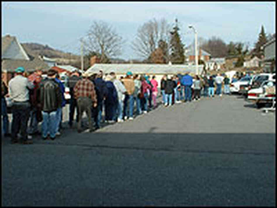 Waiting in line for food at the Second Harvest Food Pantry in Akins, Va.