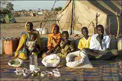 The Aboubakar family of Darfur province, Sudan, in front of their tent in the eastern Chad.