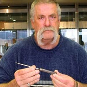 Howard Dully holding one of Dr. Walter Freeman's original ice picks, January 2004.