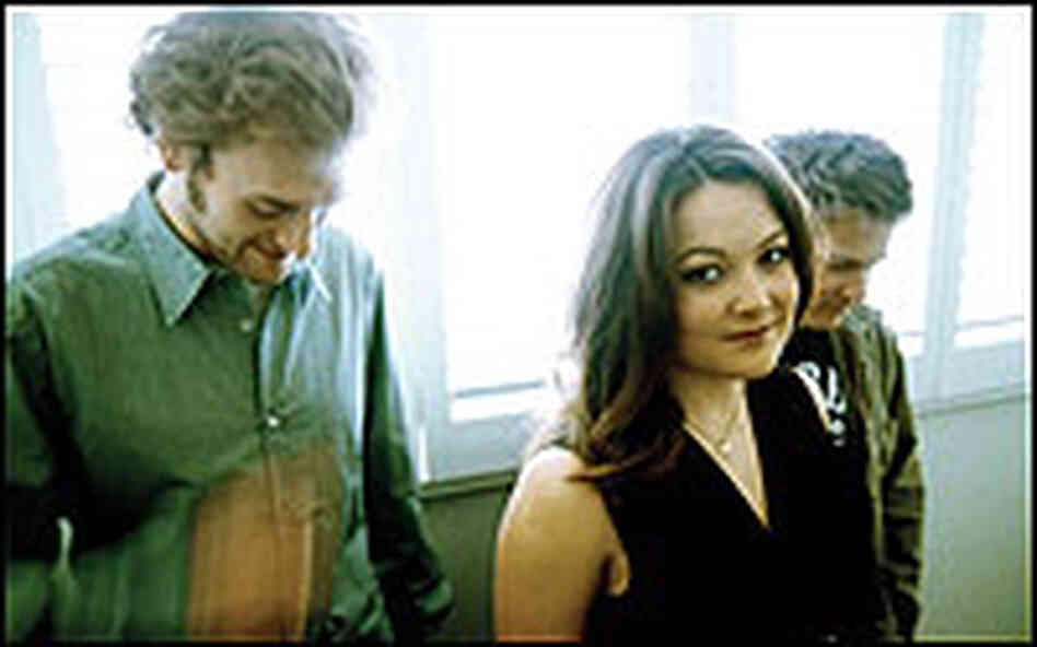 Color photo of Nickel Creek band members.