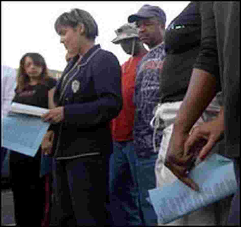City Councilwoman Cynthia Willard-Lewis prays with New Orleans East residents.