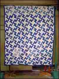 Blue-and-white 'Drunkard's Path' quilt