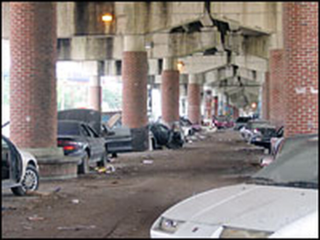 Thousands of abandoned cars stretch for blocks underneath New Orleans' I-10 interstate.