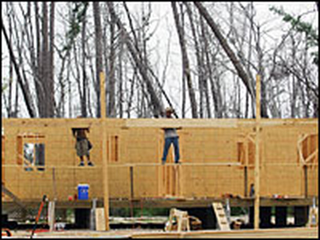 Builders work on a house in Waveland, Miss. As rebuilding progresses, there is a growing need for skilled laborers such as electricians and plumbers.