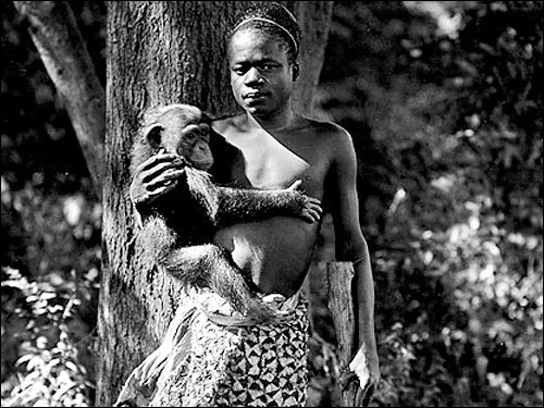 Ota Benga in the monkey enclosure at the Bronx Zoo 1906