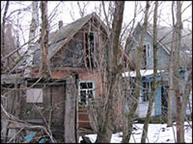 Empty village houses inside the ghost town of Chernobyl's exclusion zone.